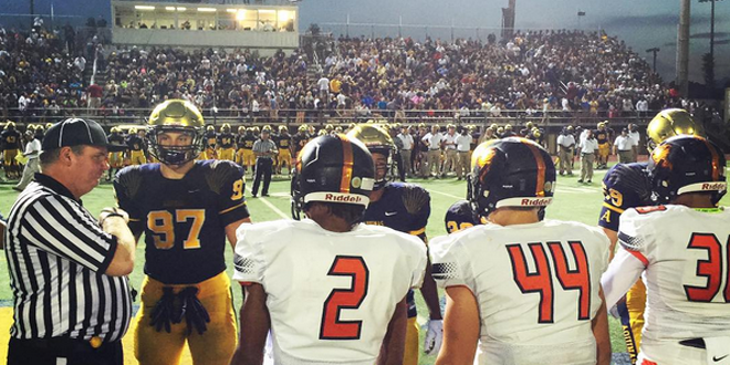 St. Thomas Aquinas and Booker T. Washington lining up for the coin toss on Friday night. Photo Courtesy of Brandon Odoi, FloridaHSFootball.com Staff