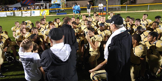 Buchholz head coach Mark Whittemore talks with the team after the team defeated rival Eastside on Friday night. Photo by Joshua Wilson.
