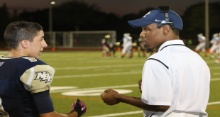 A North Broward Prep coach and player discuss a play during the game (Photo: Paul Miller)