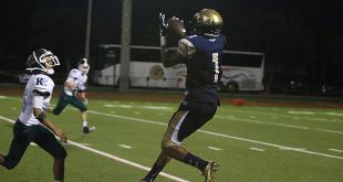 North Broward Prep receiver C.J. Riley makes a catch against Ransom Everglades. (Photo: Alex Vigna)