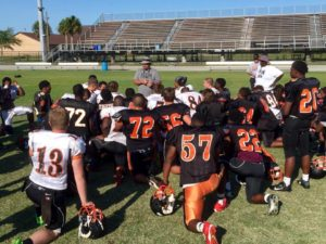 Coach Wilkinson talking to his team during spring football practices (Photo Credit: Cocoa Tigers Football)
