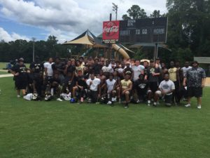 The Oakleaf Knights have been spending time at summer camps to prepare for the upcoming season (Photo Credit: Oakleaf Football)