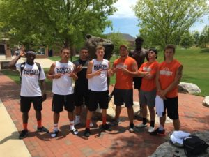 Members of the University Titans football team took part at a camp at Mercer this summer. (Photo Credit: University Titans Football)